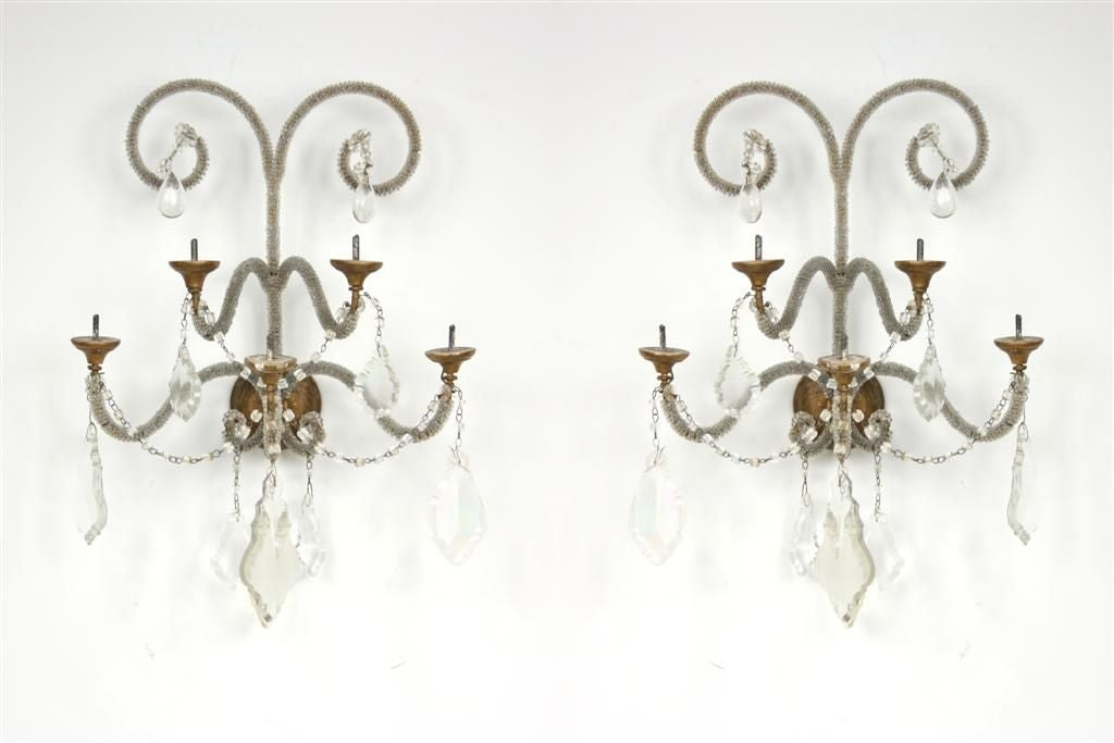 A pair of crystal and glass beaded five-arm sconces with giltwood bobeches,
