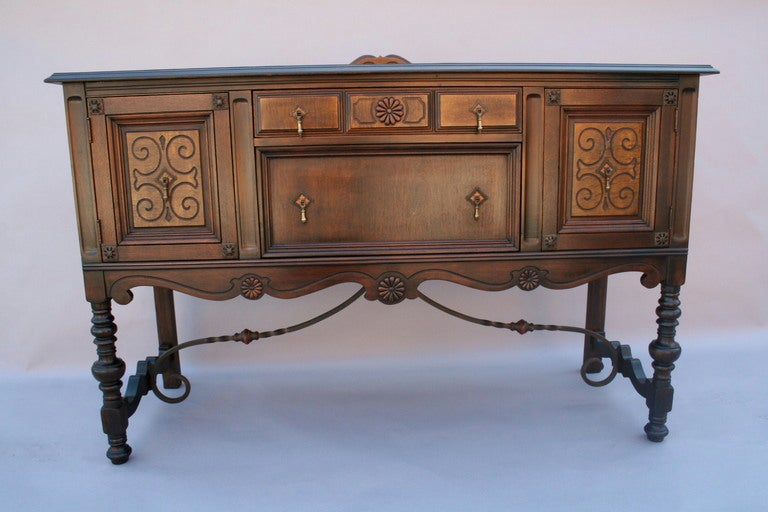 Walnut sideboard with wrought iron stretcher at stdibs