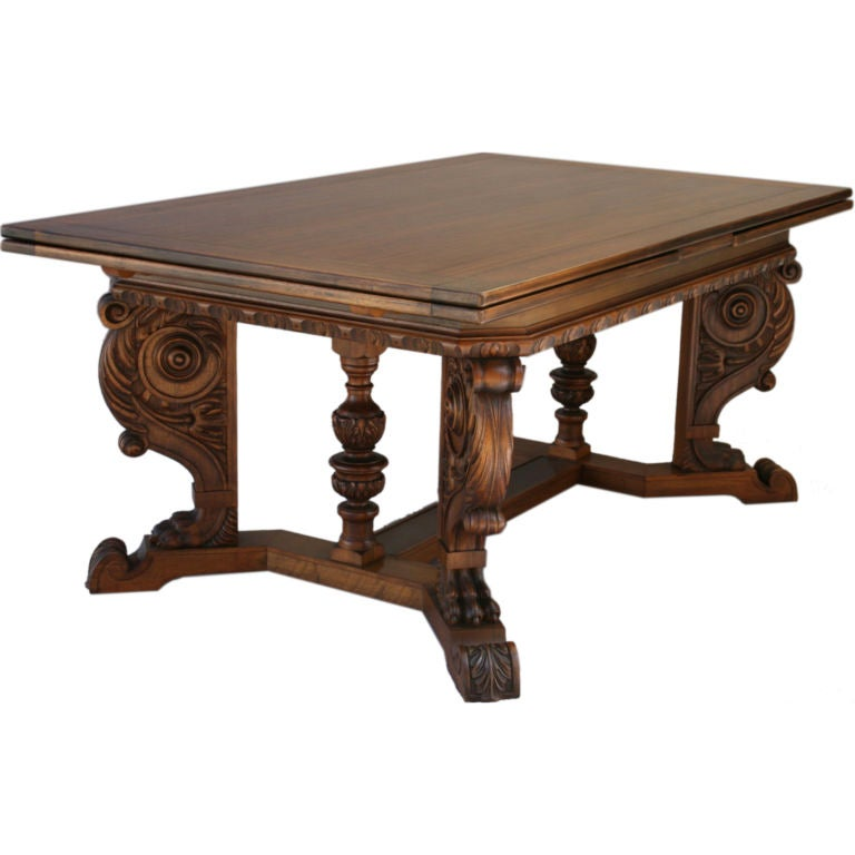 this very long carved walnut dining room table is no longer available