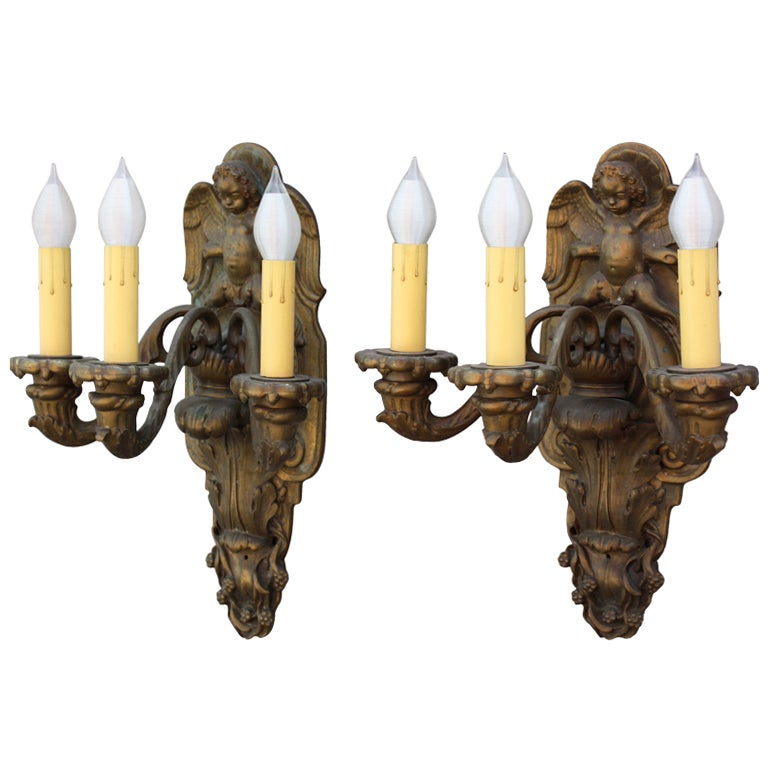 Pair of Bronze Sconces with Winged Cherubs and Acanthus Motif