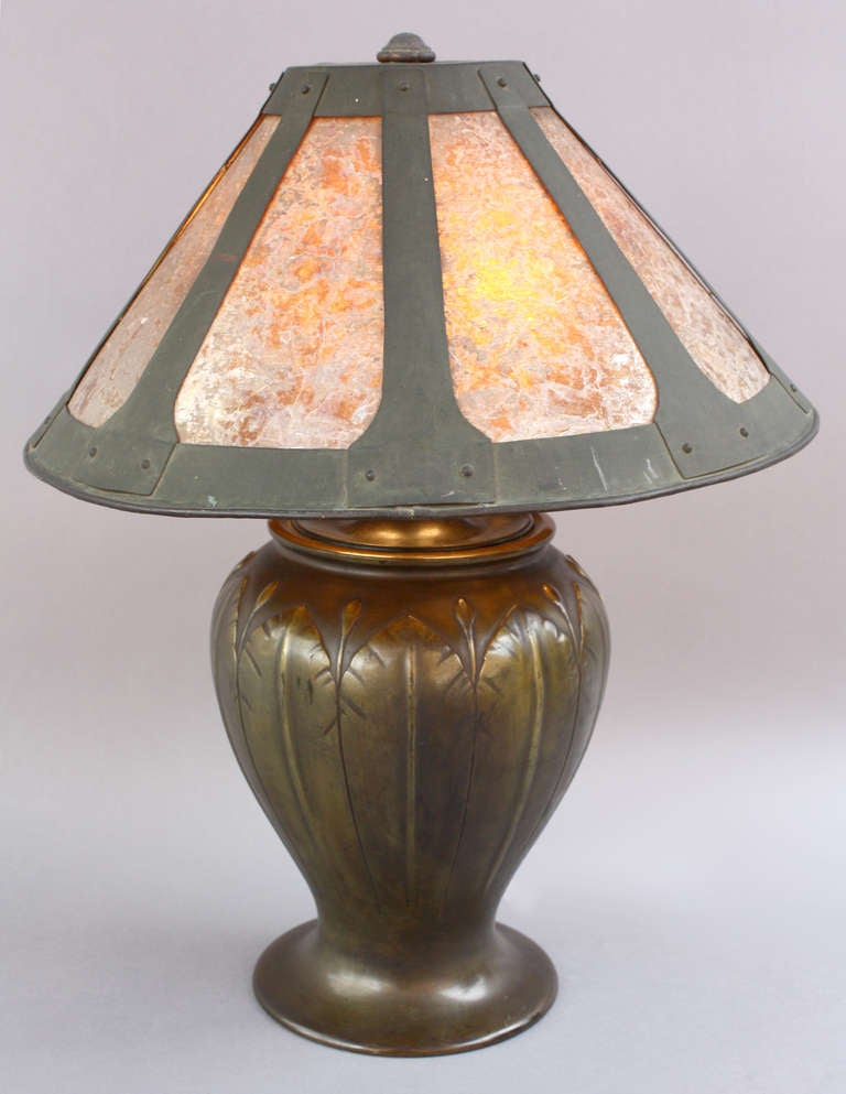 The bronze pass is Japanese pre-1910 and the shade is circa 1910. During the height of the arts and craft period it was not usual to see this type of marriage