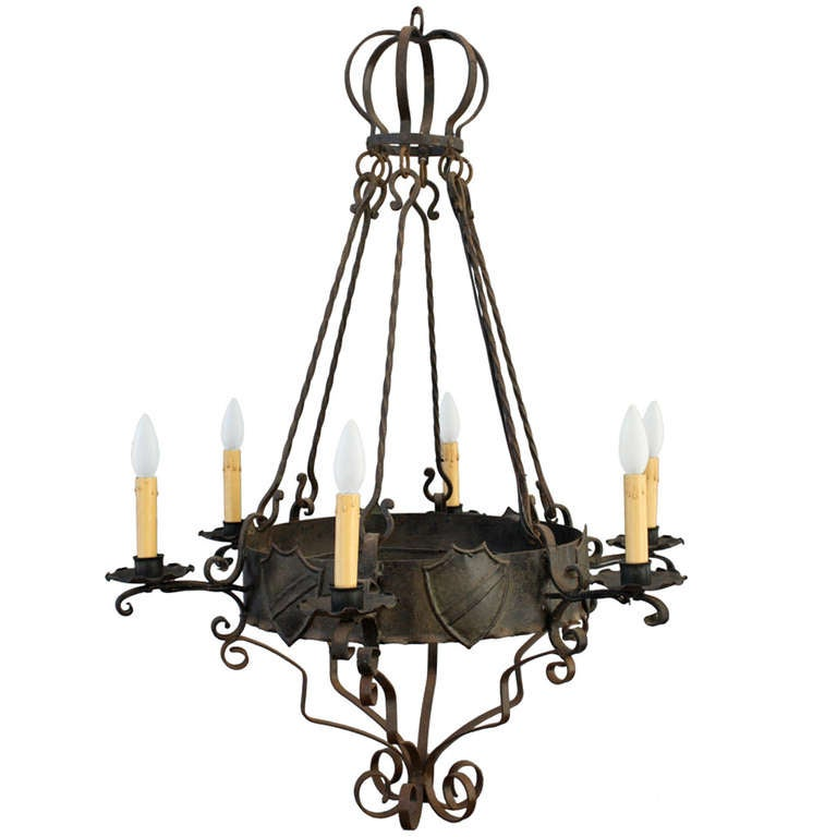 Spanish revival chandelier with shield crest motif at 1stdibs for Spanish revival lighting