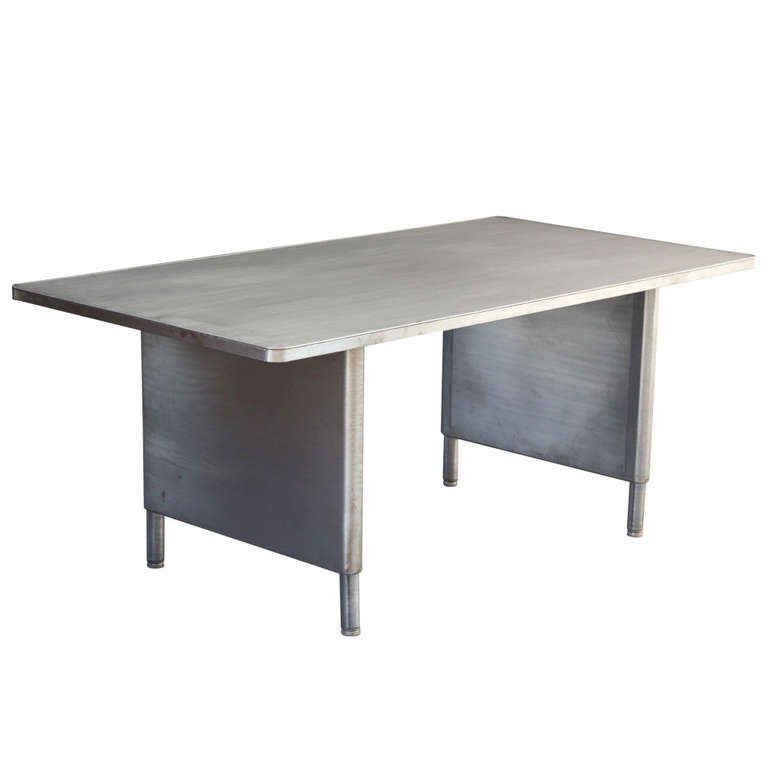 Long metal industrial table with adjustable legs at 1stdibs for Furniture work table