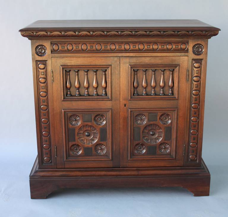 Circa 1920's . A beautiful side piece with all original finish. Carved  walnut. Wonderful - Antique 1920s Spanish Revival Cabinet By Kittinger At 1stdibs