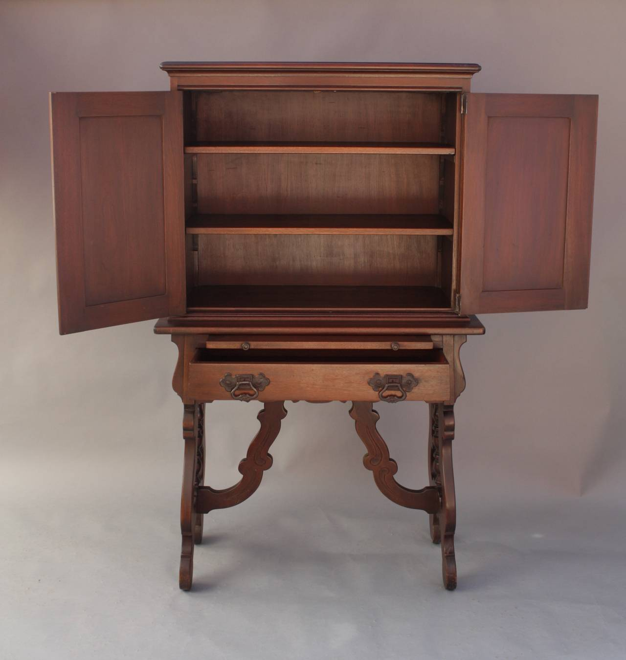 Walnut Carved 1920s Cabinet with Elaborate Hardware at 1stdibs
