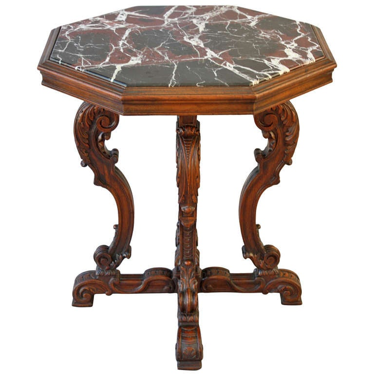 Octagonal carved table with marble top at stdibs