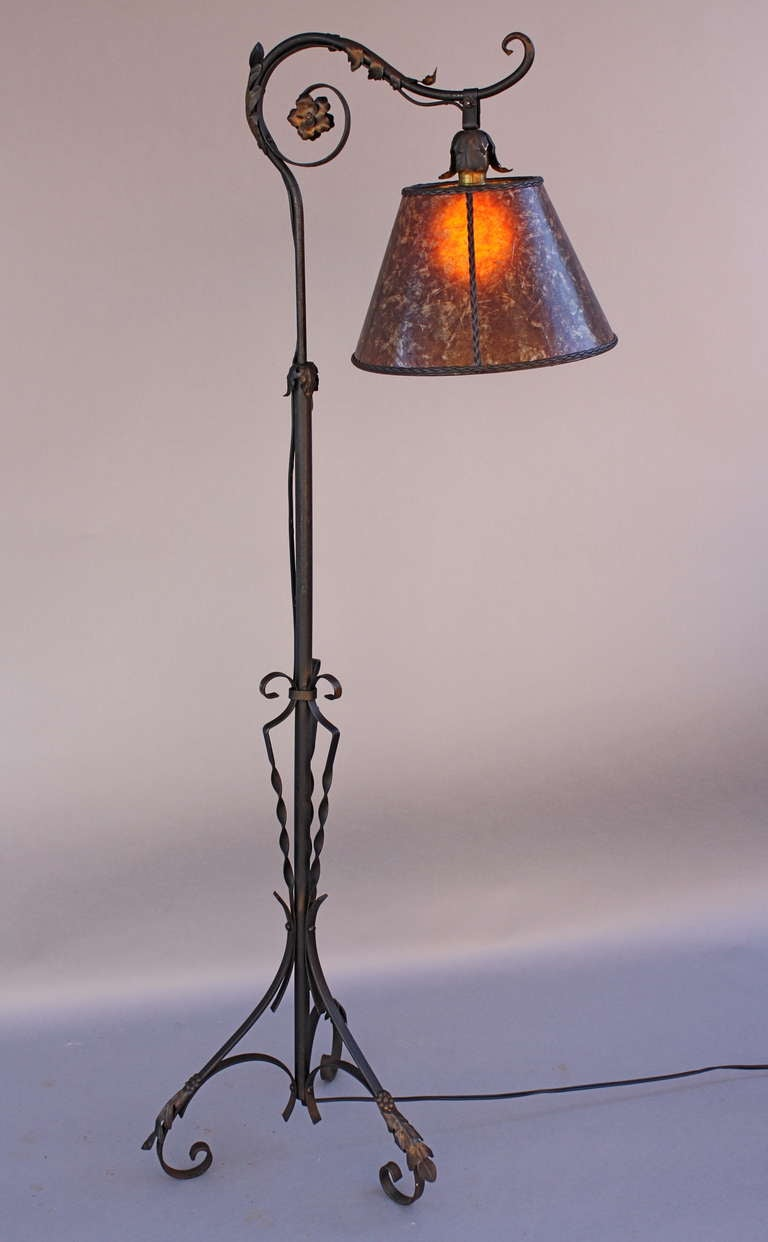 Spanish Revival Furniture 1920s Wrought Iron Bridge Lamp with Amber Mica Shade at 1stdibs