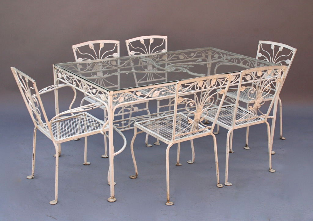 nicely styled and heavy wrought iron patio table with 6