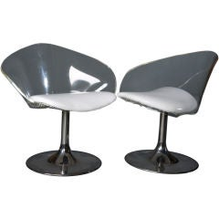 Pair Of Lucite Swivel Chairs