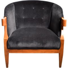 Turned arm lounge chair by Baker