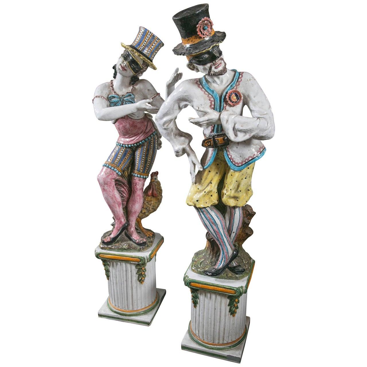 Pair of Glazed Terra Cotta Masqueraders