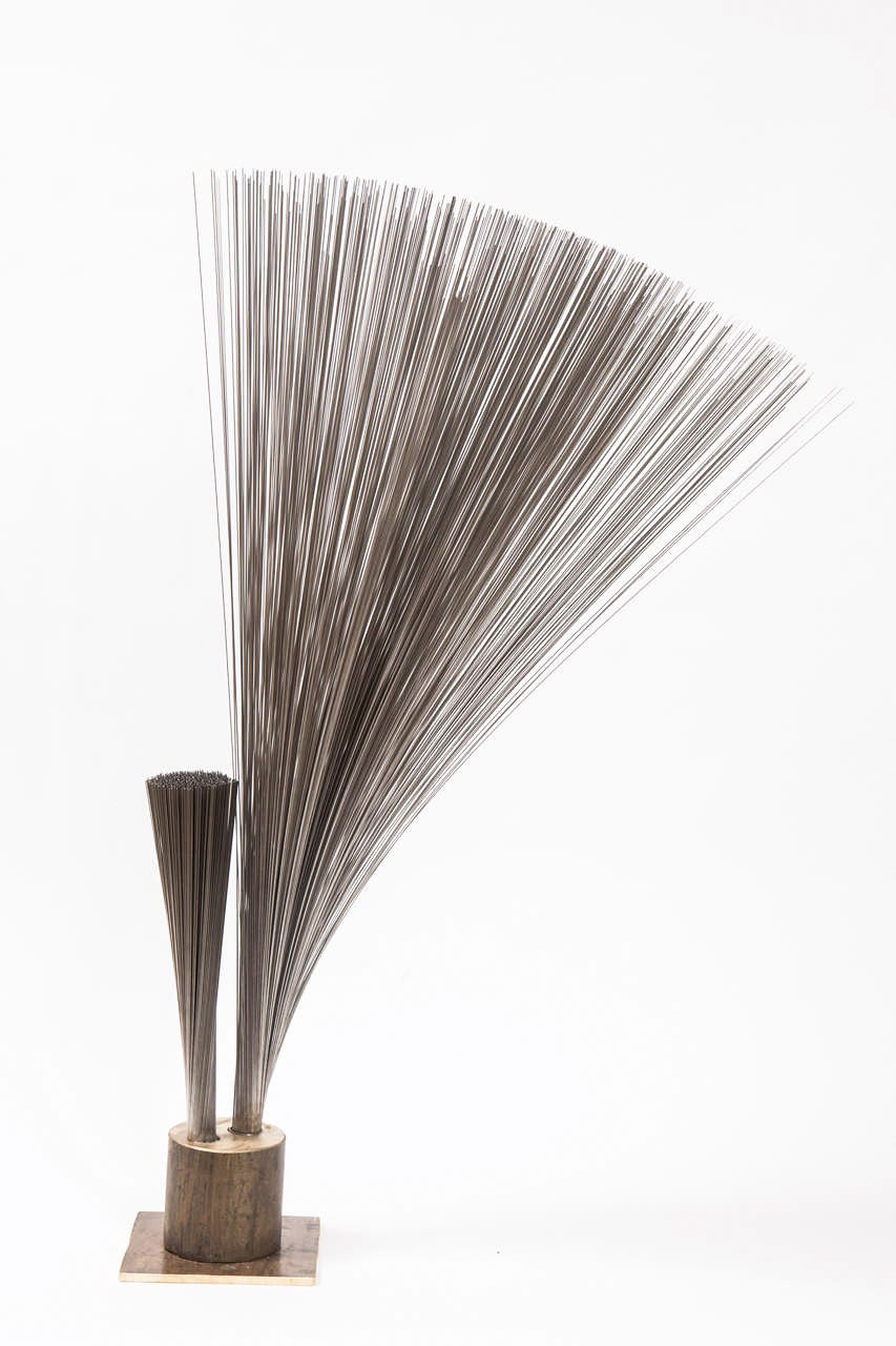 "Contemporary artist Val Bertoia's ""Double Vertical Spray Sculpture"". This Kinetic sculpture was made by cutting one grouping of stainless-steel wires that were made by Harry Bertoia (circa 1950s-1960s) to make two vertical sprays. The"