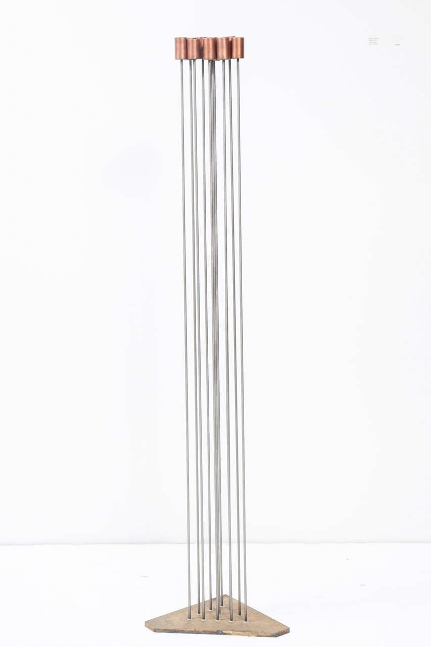 """Contemporary artist Val Bertoia's """"Corner Sound Sculpture"""" is part of the Bertoia Sonambient series. It's made of 11 copper tops silvered to monel rods then silvered to a brass base. This 2008 piece is inscribed B-1524 on the side of base"""