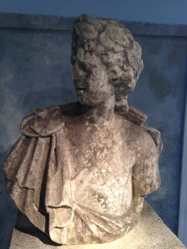 Hand-carved from marble after the Apollo Belvedere and dating to the late 18th century, this exquisite life-sized bust is in excellent condition, with only a very old and invisible repair to the nose. It will make a perfect addition to your library