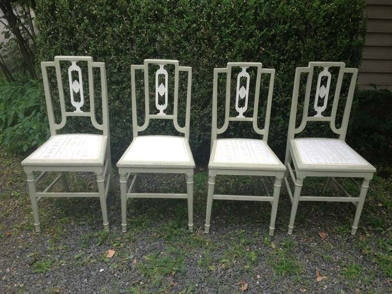 We bought these beauties in England but think they may be Swedish. In soft sage green paint with incised white splay backs, they would make a lovely additional to a casual eating area. Dainty in appearance, they are in excellent sturdy condition,