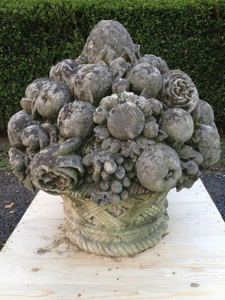 Huge pair of magnificently carved stone fruit and flower