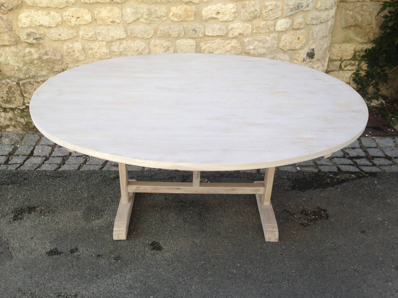 This stunning vendange (wine-tasting) table hails from the southwest of France and dates to the late 19th century. The original poplar top and oak base have been beautifully-refinished in a translucent pale grey milk paint that has been coated with