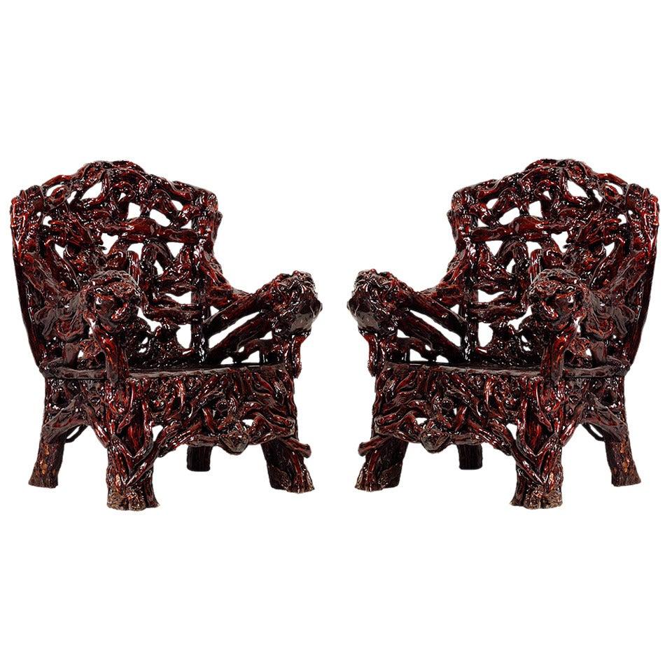 This pair of large burmese arm chairs is no longer available - Pair Of Dark Root Chairs 1