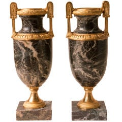 Pair of Neo Classical style marble urns with gilt bronze mounts