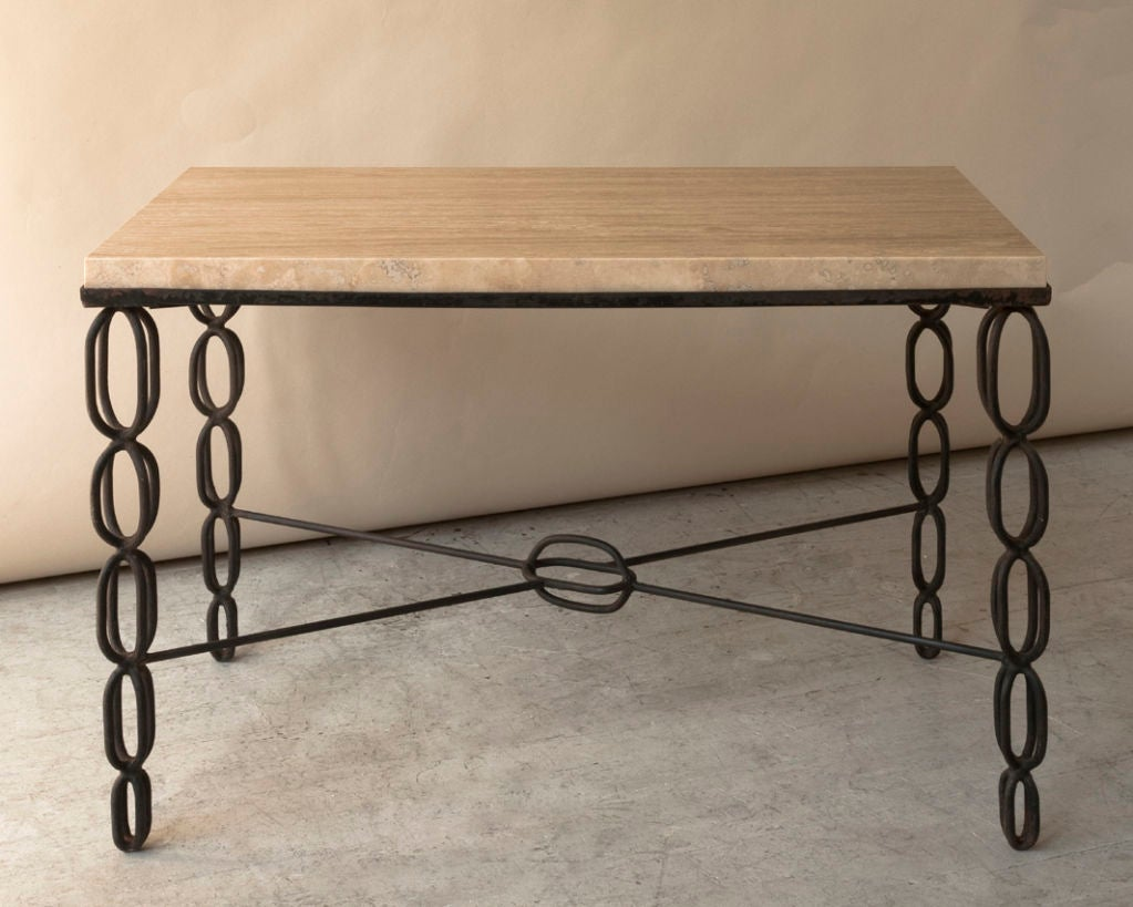 small wrought iron and sealed travertine coffee table at