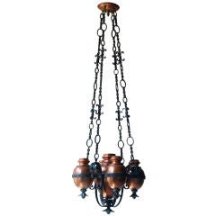An Unusual Arts and Crafts hanging fixture with copper urns