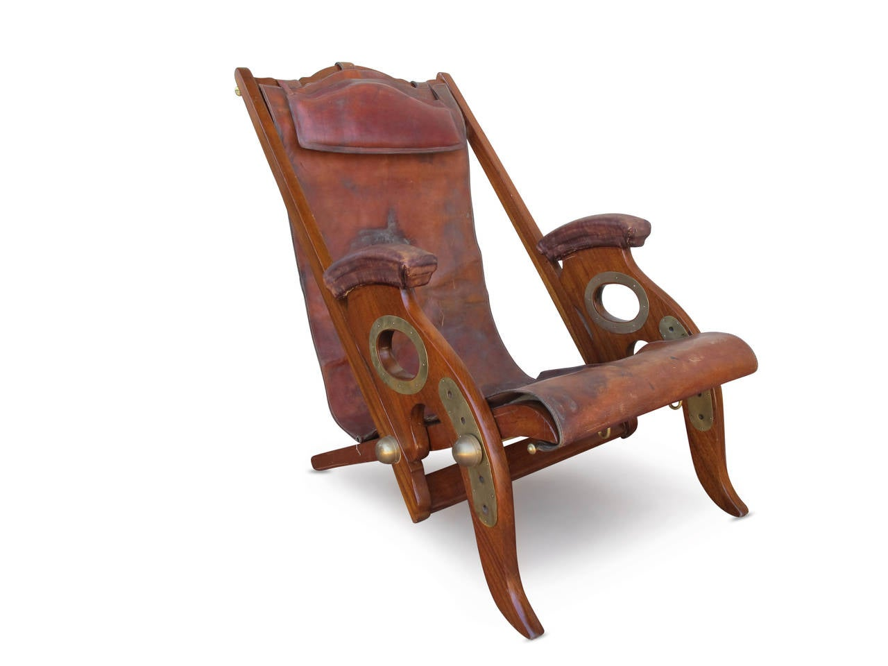 The X-frame chair folds flat and the arms also fold. The leather buttoned seat is both removable and adjustable. Padouk, a tropical hardwood from Andaman Islands, South East Asia and Burma. Incredible brass details.  Anglo-Indian, circa 1810-1830.