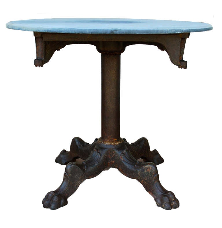 Beautiful cast iron industrial round table with stone top for Cast iron table ends