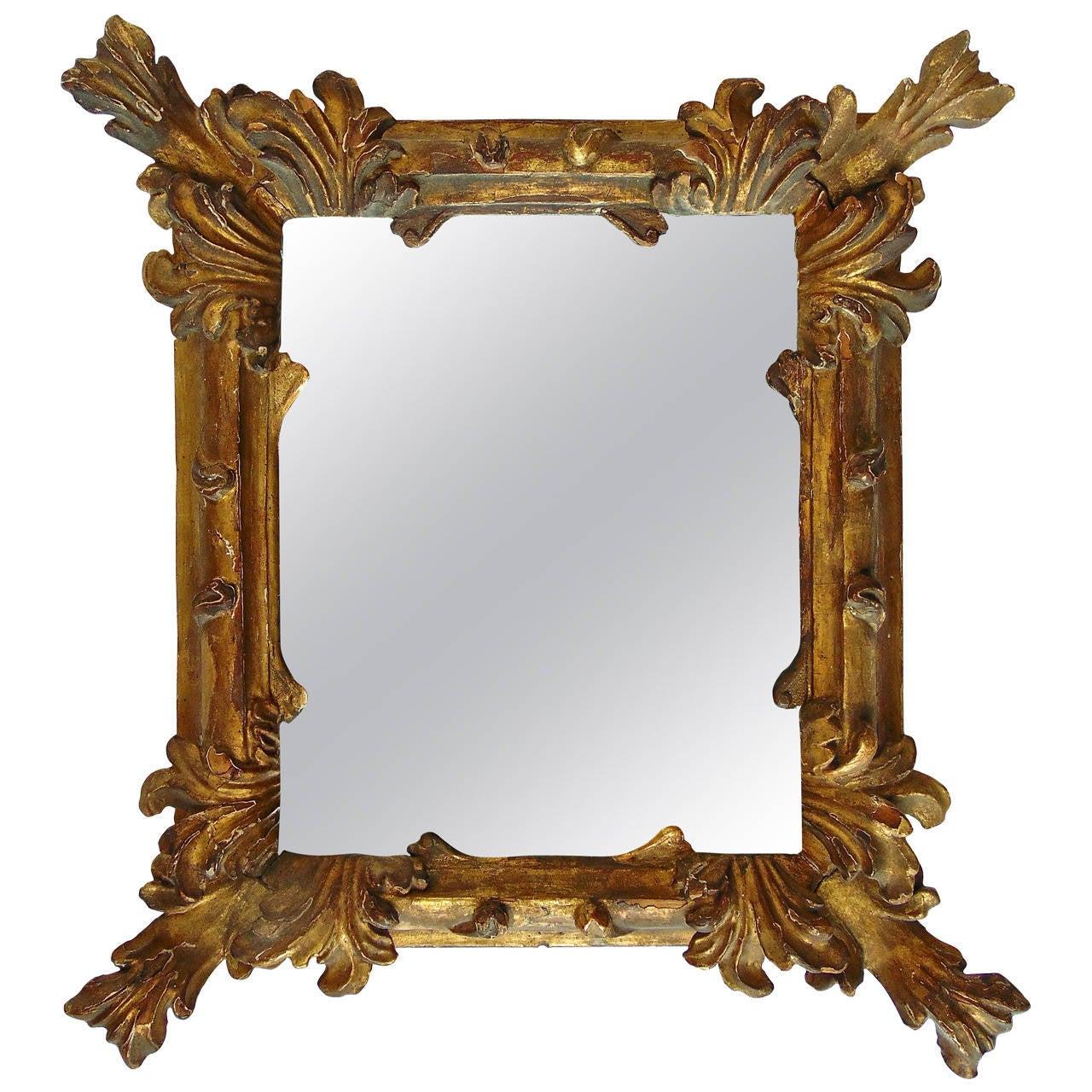 Period 18th century italian baroque carved gilt mirror at for Italian baroque mirror