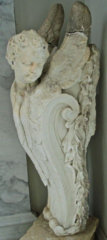 Important Pair of German Baroque Carved Marble Corbel Brackets.  Influenced clearly by Bernini yet representative of the full German Baroque tradition.  Angel figures, one of a youth, one of an adolescent.