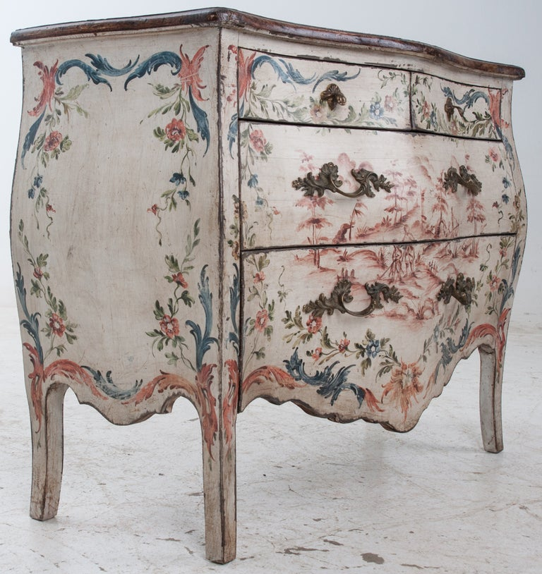 From the late 1800's,is a beautiful Italian painted Bombe 4-Drawer Chest of drawers with faux Marble Top. The chest is well constructed with bowing sides and front and hand painted in a floral design. The background color is cream with painted
