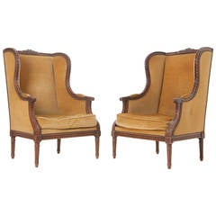 Pair of French 19th Century Carved Walnut Wingback Bergeres