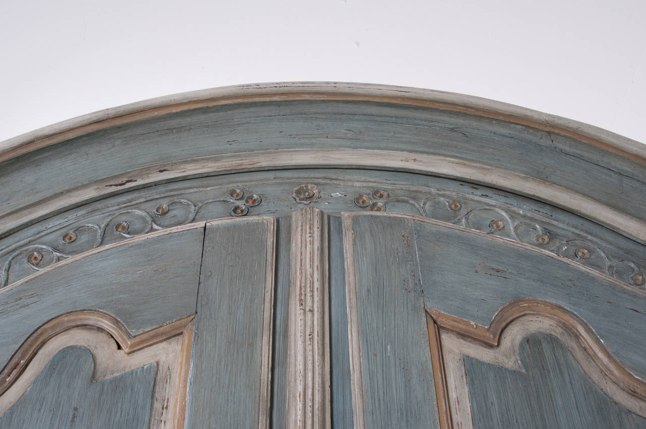 An early carved cherrywood armoire coming from Bordeaux, most likely would have been a wedding present with carvings of flowers and a heart. All steel hardware in locking and working condition. This fine armoire has recently been painted to seem as