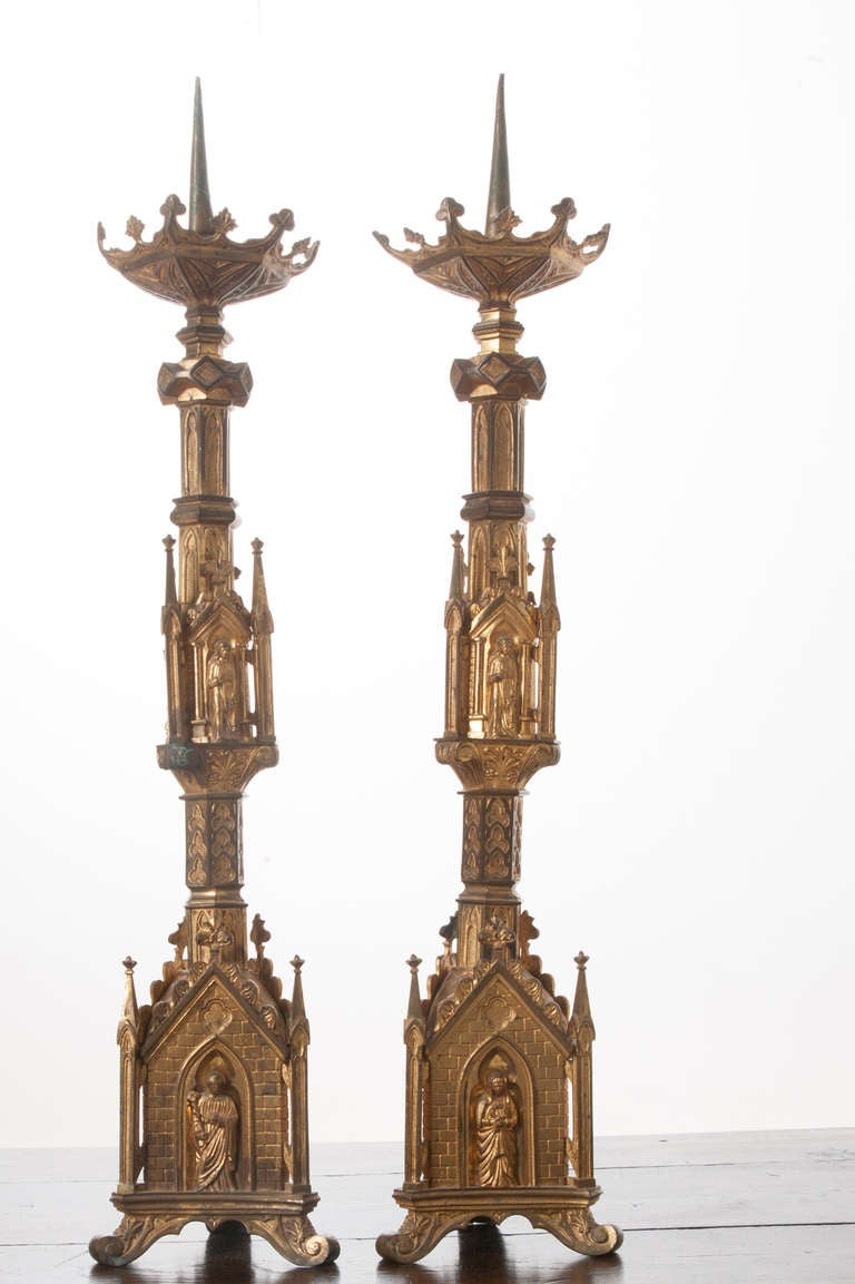 A stunning pair of European Gothic Revival candlesticks from a church altar, made of gilt bronze with exuberant detail. The pair is tasteful on all sides, the detail will amaze you as well as their weight! 1860s.