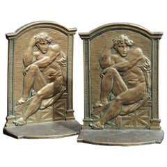 Seated Nude Male Bookends with Fine Bas Relief Detail