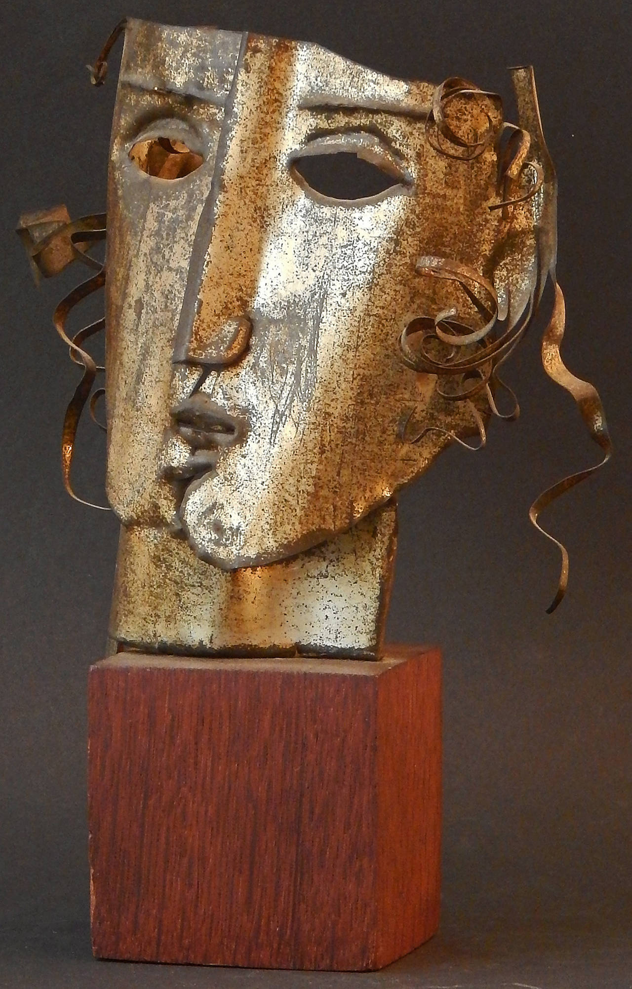 A very fine example of Cubist sculpture, executed in gilt tin cut and shaped into human form, this piece was sculpted by Edmund Kinzinger, a German-born artist who settled in America in the 1920s and taught in Minnesota and Texas over a long career.
