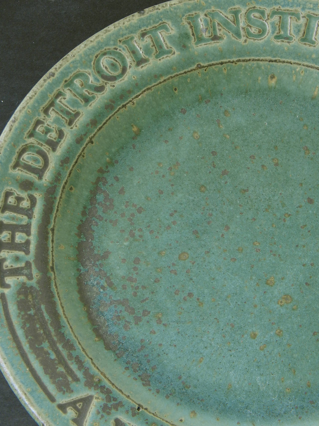 Crafted by one of America's finest Arts and Crafts potteries long after the era was over, this charger, glazed in a lovely, deep forest green, was made by Pewabic Pottery in Detroit for an annual holiday event hosted by the Detroit Institute of