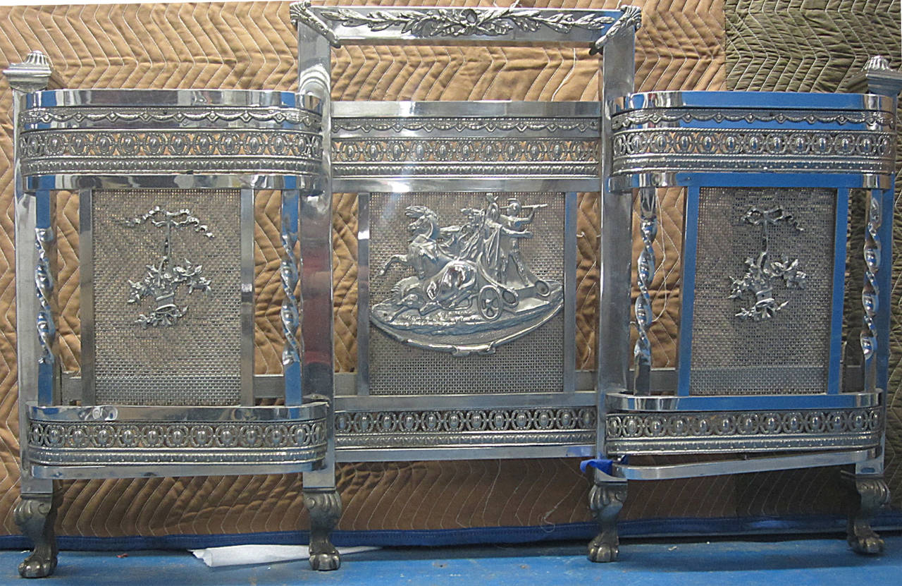 This remarkable full size bed, with elaborately finished headboard and footboard, all in nickeled brass, was made in France in the 1920s as Classical design was merging with Art Deco. The central panels depict a horse and chariot motif in vivid bas