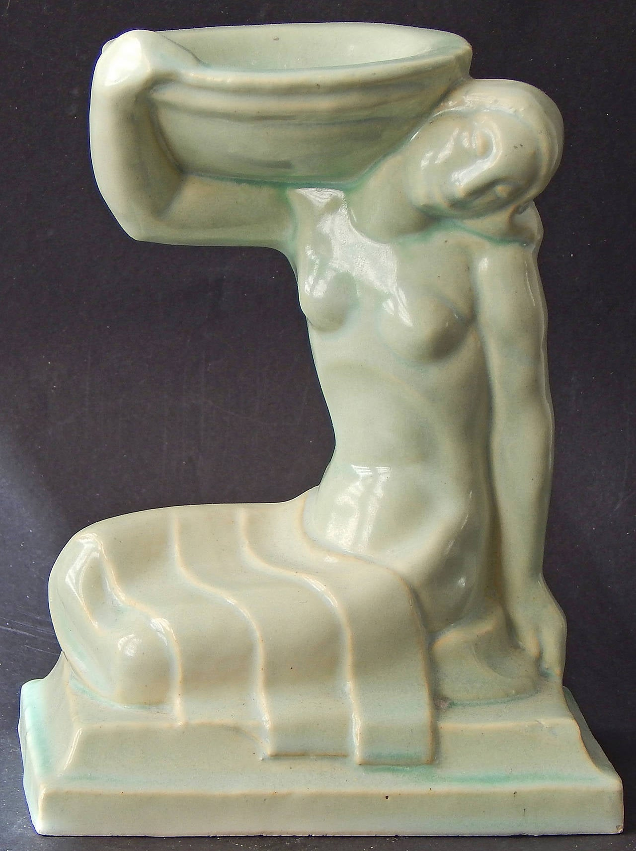 A classic and rare example of Art Deco sculpture, this piece was designed by Leon Victor Solon, an important color theorist and designer who became the artistic director of the American Encaustic Tile Company (AETCO) in 1922.  American Encaustic