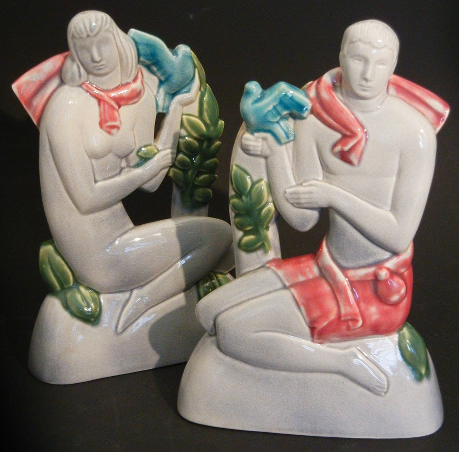Probably sculpted by Geza De Vegh for Phoenix Pottery, this rare pair of very fine ceramic sculptures depict highly-stylized male and female figures, each holding doves. The gray, deep pink and blue-green glazes are gorgeous.