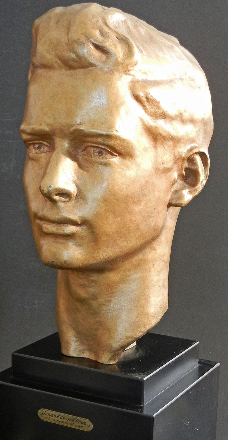 Beautifully crafted in gilded bronze, this extraordinarily handsome portrait of a young man, 15 years of age, was sculpted by Pietro Montana in 1932.  Complete with its original base indicating the name and age of the sculptor's subject, this piece
