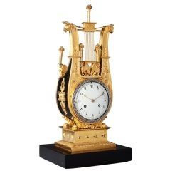 A Charles X Bronze And Ormolu Clock