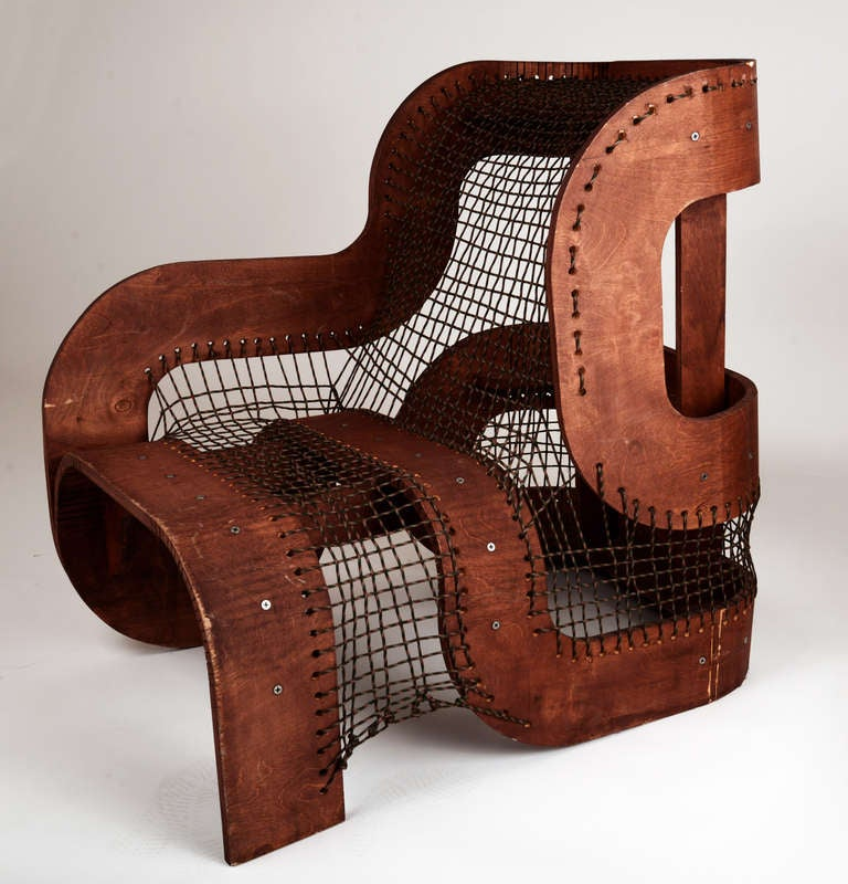 Sculptural wood and rope chair at stdibs