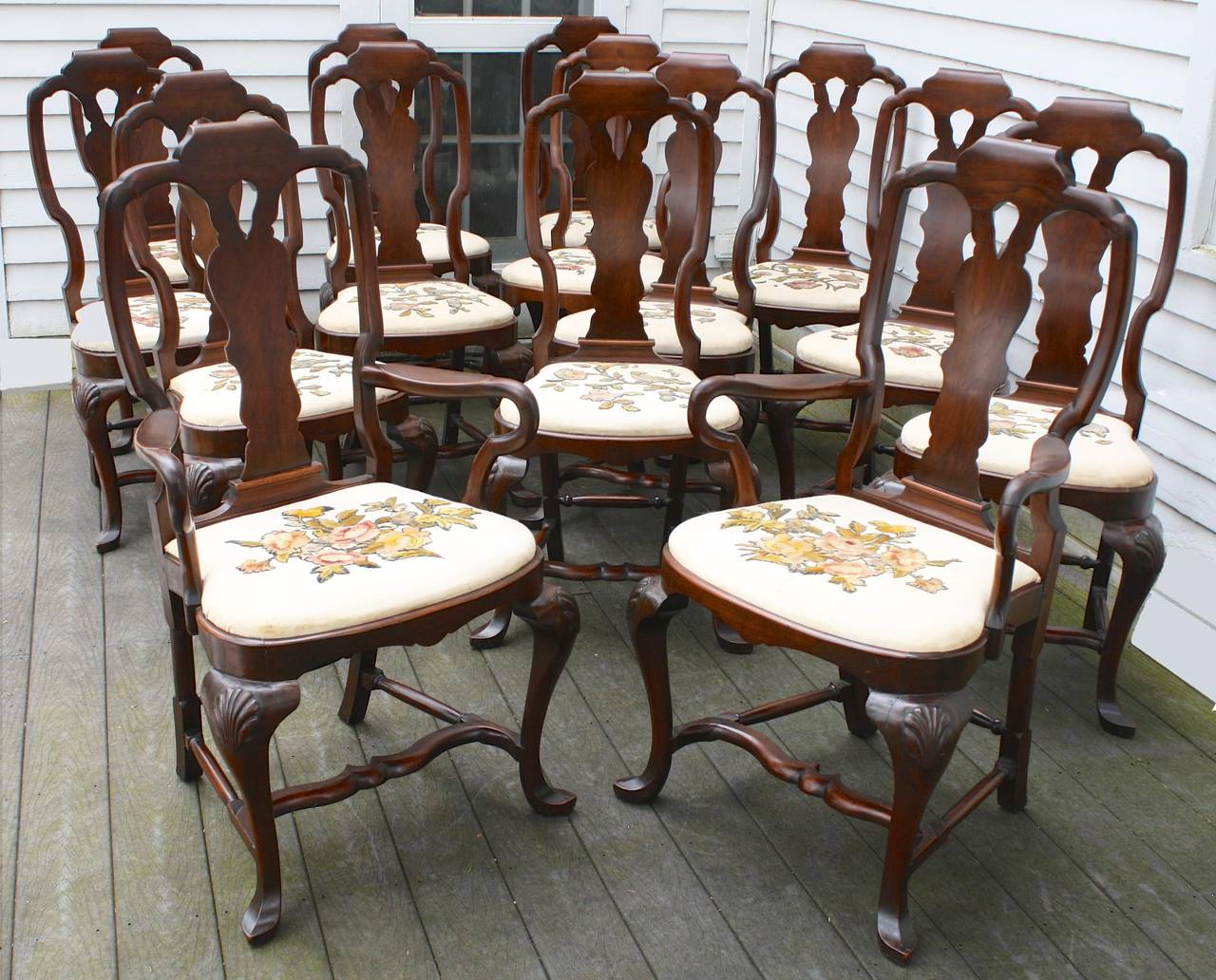 Fourteen american queen anne revival dining chairs for