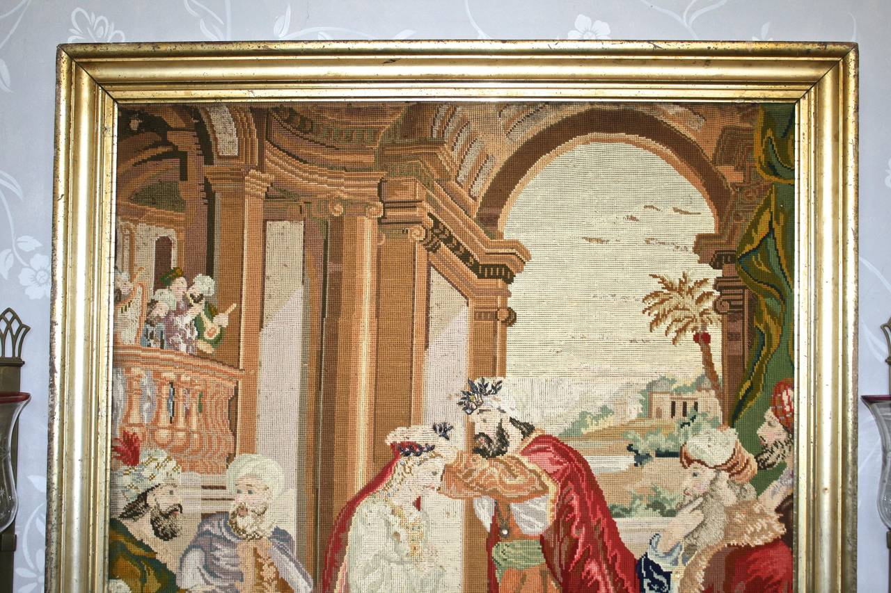 A grand framed needlepoint tapestry of the nuptial celebration and crowning of a Turkish Panguian (Sultana) in the Royal Courtyard presumably at the Topkapi Palace of the Sultan; overlooking the Bosphorous. The depicted event likely took place