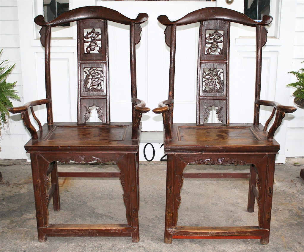 A matched 'facing' pair with yoke crest rails, humpback splats each with three medallions centered with a pierce-carved wild deer, flat raised edge panel seats, and arms with grips resembling the crest rail yoke form. The four rectangular straight