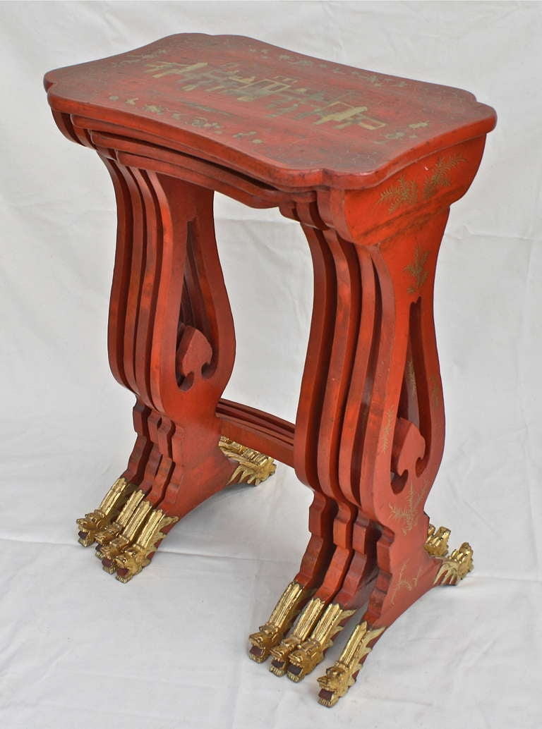 In rare persimmon lacquer with outstanding carved and gilded dragon feet.  Meticulously detailed parcel-gilt palace scenes; with up to sixteen courtiers and architectural follies. The table tops are not just simply rectangular.  Superb Chinese
