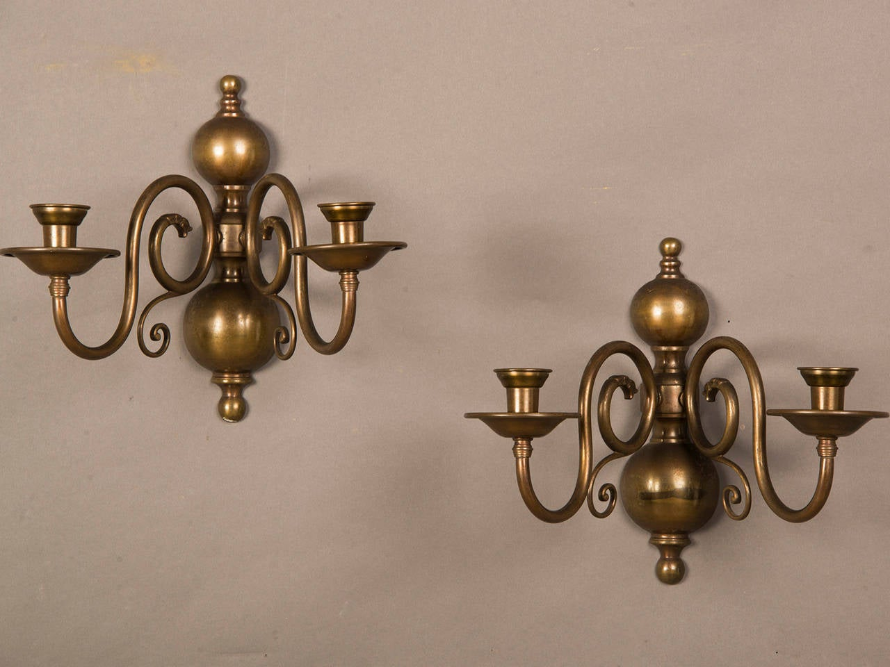 """Receive our new selections direct from 1stdibs by email each week. Please click """"Follow Dealer"""" button below and see them first!  A pair of two arm sconces circa 1920 retaining their original dark bronze finish. These are the classic Dutch style"""