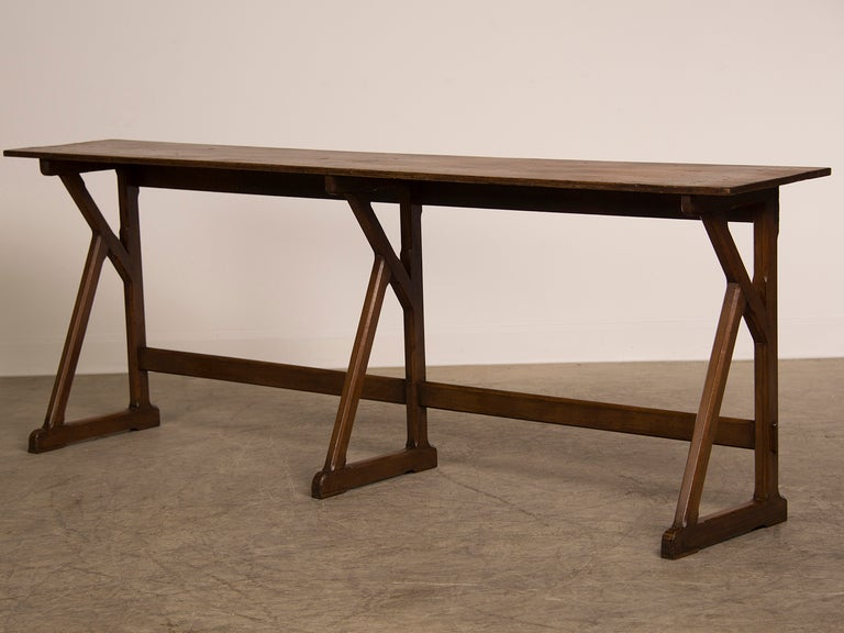 An exceptionally long and shallow fruitwood server table from france c