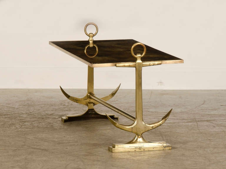 nautical theme brass coffee table with marbled mirror glass