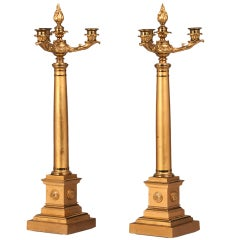 A pair of Empire period gilt bronze tall candlesticks from France c.1825